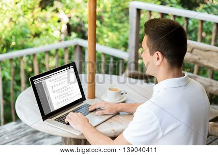 business, programming, people and technology concept - close up of businessman typing on laptop computer with coding on screen outdoors on summer terrace and drinking coffee