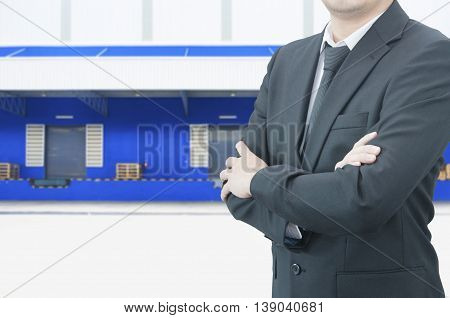 Professional Business Man With Blurred Distribution Warehouse Dock Background, Industrial Business C