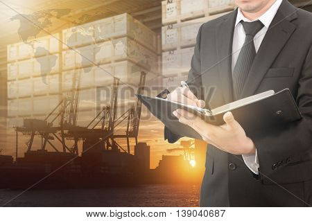 Double Exposure Of Businessman Is Booking With Blurred Cargo , Transportation Port And World Map, El