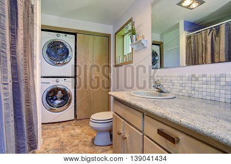 Simple Yet Elegant Bathroom Interior With Built-in Laundry Appliances