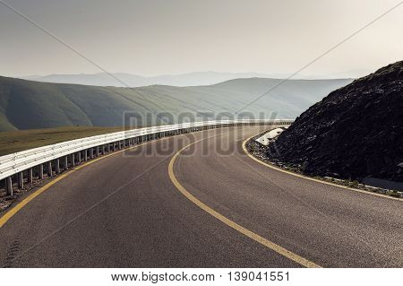 Mountain road at sunrise / Transalpina highway, the highest road in Romania