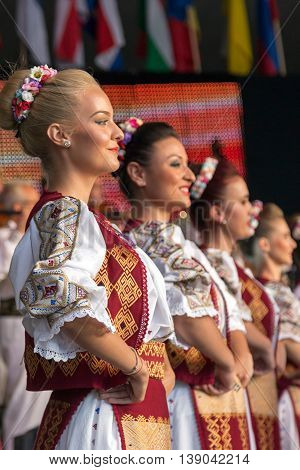 ROMANIA TIMISOARA - JULY 8 2016: Young dancers from Romania in traditional costume present at the international folk festival