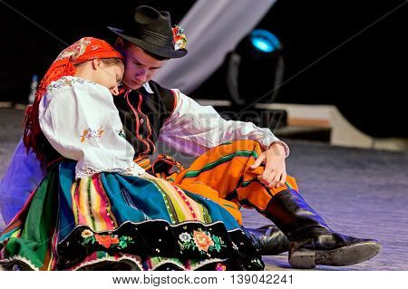 ROMANIATIMISOARA-JULY 72016:Young Polish dancers in traditional costume perform in one show at the international folk festival