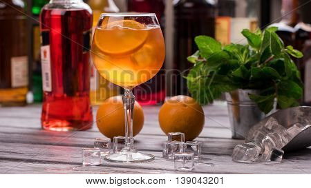 Orange drink in wineglass. Ice cubes and oranges. Recipe of Aperol spritz. Tastiest cocktail in our bar.