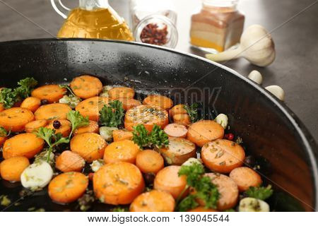 Healthy food and ingredients with sliced carrots, parsley and spices