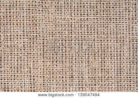 Natural burlap tablecloth texture background, close up