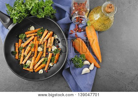 Healthy food and ingredients with sliced carrots, parsley and spices on dark background