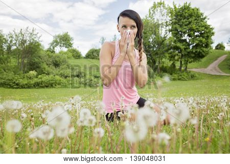 A young woman suffering spring pollen allergy
