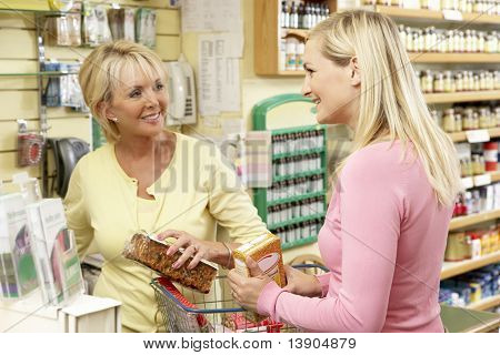 Sales assistant with customer in health food store