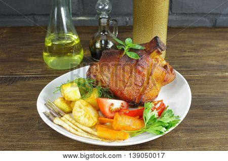 appetizing baked knuckles of pork on plate