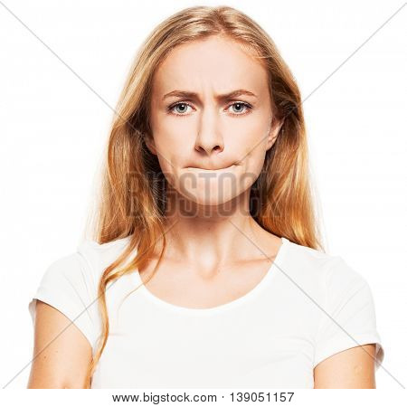 Frightened woman. Female with pinched lips. Abuse