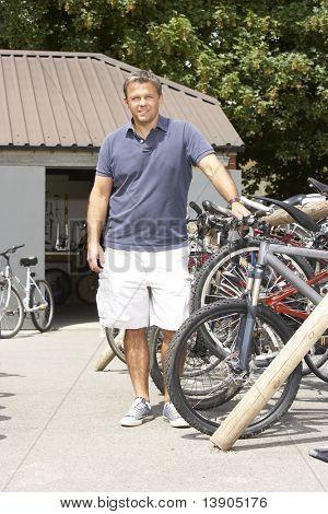 Owner of cycle shop in workshop