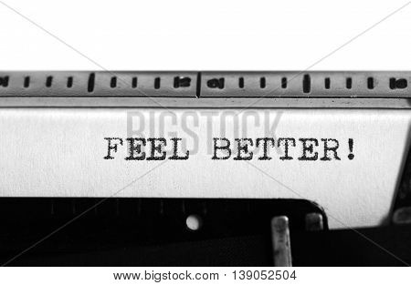 Typewriting on an old typewriter. Typing text: feel better