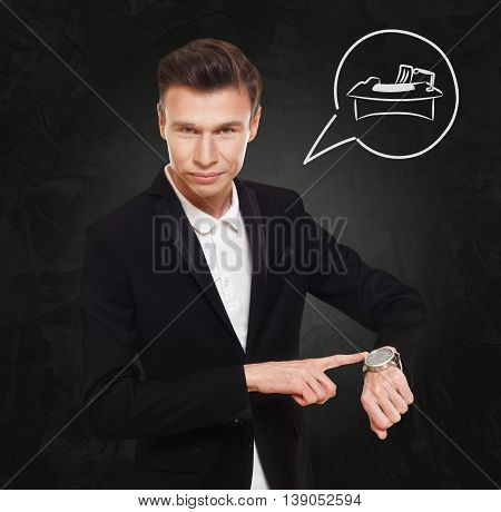 Time to find a job in office. Businessman point at his watch showing working table, hardworking or HR concept. Man in suit with watch at black background, thinking cloud with work place.