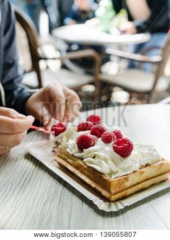 women eating belgian waffles