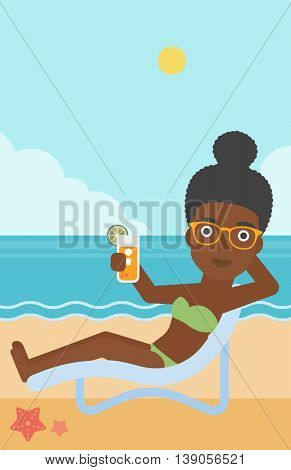 An african-american woman sitting in a chaise longue and holding a cocktail in hand on the background of sand beach with blue sea. Vector flat design illustration. Vertical layout.