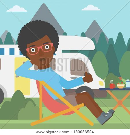 An african-american woman sitting in folding chair and giving thumb up on the background of camper van. Woman enjoying vacation in camper van. Vector flat design illustration. Square layout.
