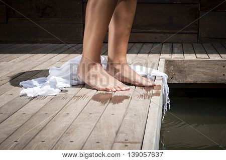 Close Up Of Young Attractive Woman's Legs And Feet Next To Pool