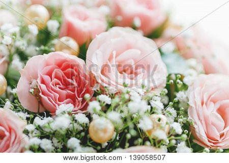 Wedding bouquet. Bride's traditional symbolic accessory. Floral composition with roses.