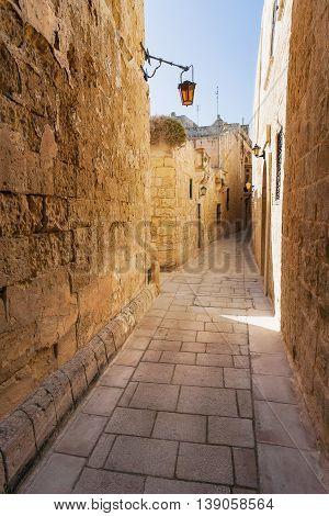 Ancient narrow street in Mdina old capital of Malta.