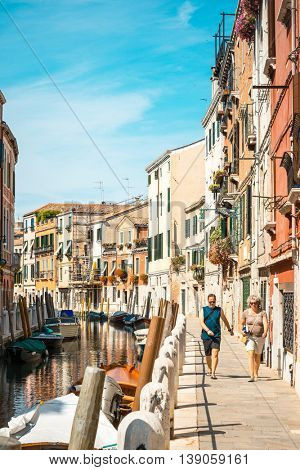 VENICE, ITALY - June 30, 2016.Traditional street view of old buildings in Venice on May 26, 2015. its entirety is listed as a World Heritage Site, along with its lagoon.May 26 VENICE, ITALY