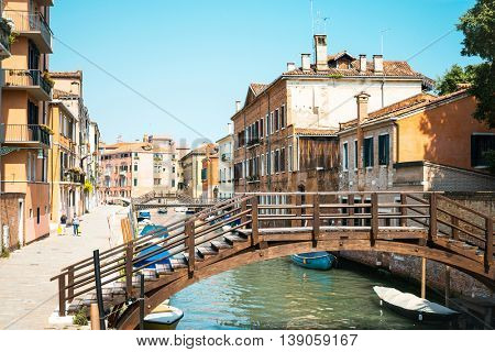 VENICE, ITALY - June 30, 2016. Beautiful view of water street and old buildings in Venice on May 26, 2015. its entirety is listed as a World Heritage Site, along with its lagoon.May 26 VENICE, ITALY