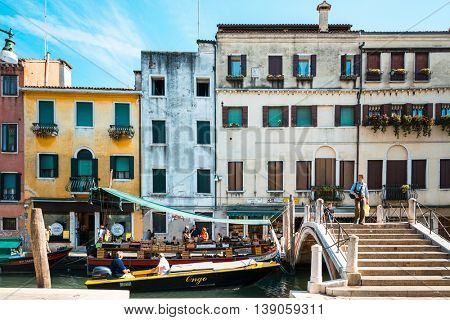 VENICE, ITALY - June 30, 2016.Tourists foot Street in Venice. its entirety is listed as a World Heritage Site, along with its lagoon. VENICE, ITALY.