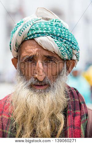 SRINAGAR INDIA - JUNE 11 2015: Unidentified Indian muslim man in the street market