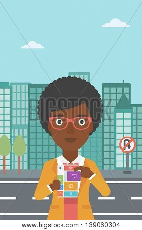 An african-american woman holding modular phone. Woman with modular phone standing on a city background. Woman using modular phone. Vector flat design illustration. Vertical layout.