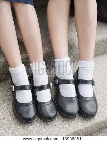Asian Thai girls schoolgirl student feet with black leather shoes as a school uniform. It is teenage education fashion.