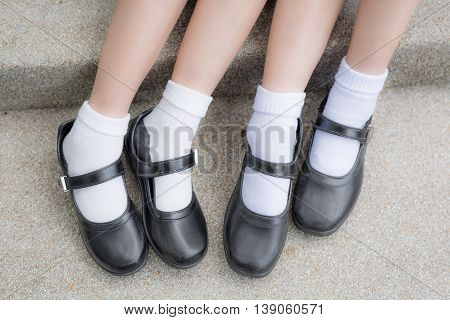 Asian Thai girls schoolgirl student feet with black leather shoes as a school uniform fashion.