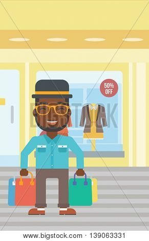 An african-american man holding shopping bags on the background of boutique window with dressed mannequins. Happy young man carrying shopping bags. Vector flat design illustration. Vertical layout.