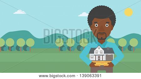 An african-american man holding house model in hands on the background of mountains. Real estate agent with house model. Vector flat design illustration. Horizontal layout.