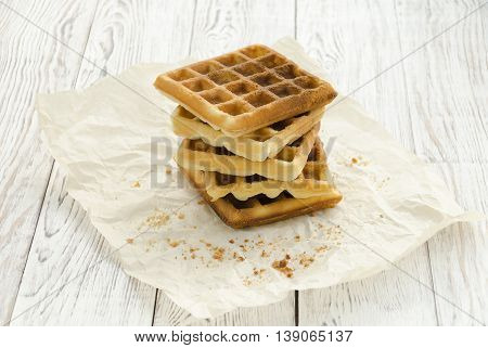 Homemade baking. Viennese waffles on wrapping paper. Copy space composition