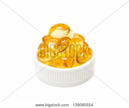 Fish oil supplement capsules in white cap isolated on white background