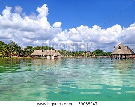Pier and beach canopies on Laguna Bacalar Mexico