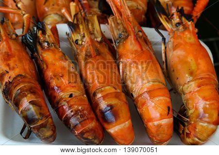 Thai local food grilled shrimp on a foam