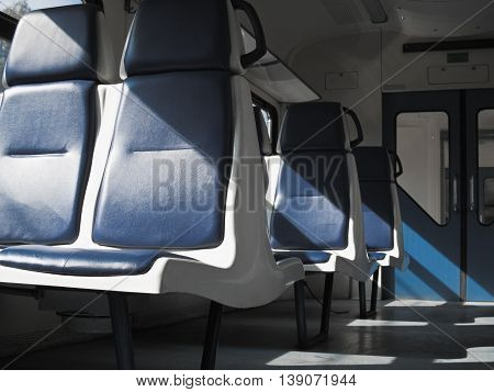 The empty seats in the car commuter train