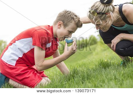 A teenager boy in sportswear run outside