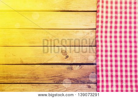 Background with wooden deck table and checked tablecloth
