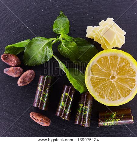 Set of chocolate candie with basil, white chocolate and almonds, chocolate collection