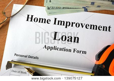 Home improvement loan form on a wooden table.