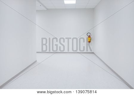 Empty white corridor background with doors on the side