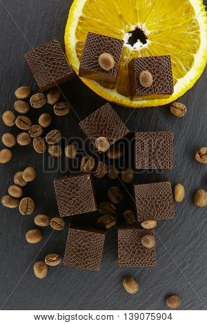 Set of chocolate candie with coffee beans and oranges, chocolate collection