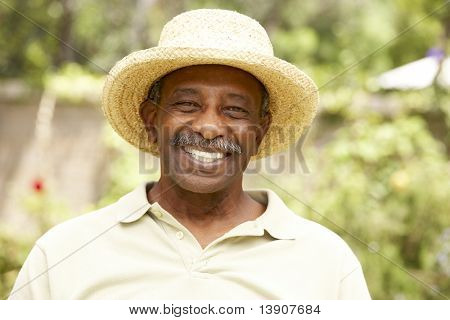 Smiling Senior Man In Garden