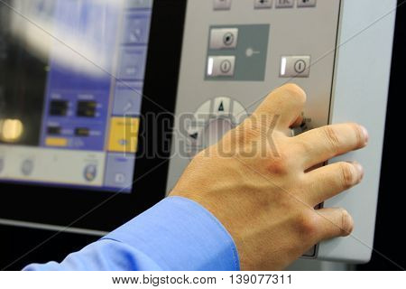 Operator controls the modern computer equipment. Selective focus on hand.