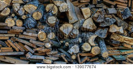 Pile of chopped firewood logs, wood planking