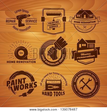 House remodeling logos. Vector labels for home renovation services. Set of vintage badges with hand tools and equipment on a wooden background