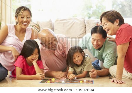 Extended Family Group Playing Board Game At Home