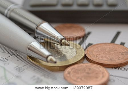 Financial background with money calculator ruler graph and pens.